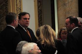 Senate President Robert Stivers talks with other legislators.