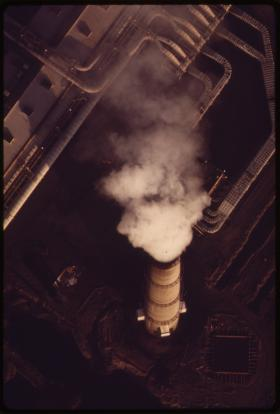 The smokestack of an aluminum smelting plant, 1973.