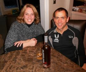 Adrienne and Andy Gordon, sampling Cleveland Whiskey in their Reminderville home