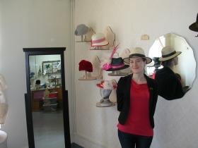 Milliner  Fielden Willmott in her shop with her hats
