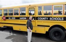 Hardin County Schools transportation director John Skaggs points out the side door and push out windows for emergency exits now required on all school buses.