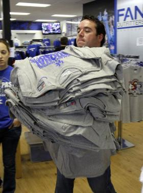 After Kentucky won the 2012 NCAA basketball title, Fan Outfitters employee Nic Johnson brought out an armload of championship T-shirts.