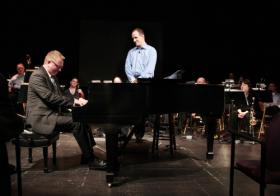 "Lexington Philharmonic conductor Scott Terrell watched piano soloist Kevin Cole during a ""Kicked Back Classics"" performance at the Downtown Arts Center in March 2011. Terrell initiated the ""Kicked Back"" series."