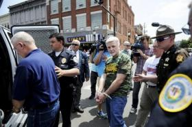 UMWA International President Cecil Roberts, with his hands bound, is lead to a police van after being placed under arrest with 14 union supporters for staging a peaceful sit-down protest in the middle of intersection at First and Main streets following a 90-minute rally.