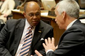 FRANKFORT— Sen. Reginald Thomas, D-Lexington (left), confers with Sen. Paul Hornback, R-Shelbyville, in the Kentucky Senate.