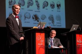 """Science Guy"" Bill Nye makes a point as Creation Museum founder and CEO Ken Ham waits for his turn during Tuesday night's debate in Petersburg, Kentucky."