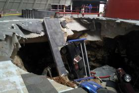 Three, possibly four, of the eight Corvettes that plunged into a sinkhole last week at the National Corvette Museum will be recovered early on in the process. The other four vehicles will be more difficult to recover, according to Mike Murphy, CEO of Scott, Murphy & Daniel. Murphy on Wednesday pointed out features of the Skydome's sinkhole to the Daily News.