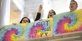 A federal judge Tuesday struck down Kentucky's ban on same-sex couples getting licenses and marrying.