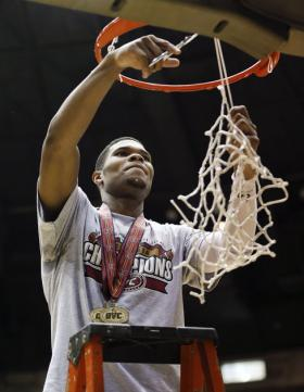 Corey Walden cuts down the championship net.