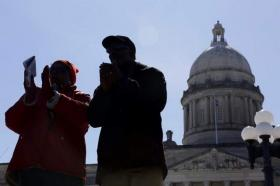 Johnny Keene, right and Mary Maxwell of Frankfort stand of the steps of the Capitol and sing 'We Shall Overcome' at the end of the 50th Anniversary of the MLK March on Frankfort program, Wednesday, Mar. 5, 2014 at the Capitol in Frankfort. Keene and Maxwell were college friends at KSU and are now neighbors