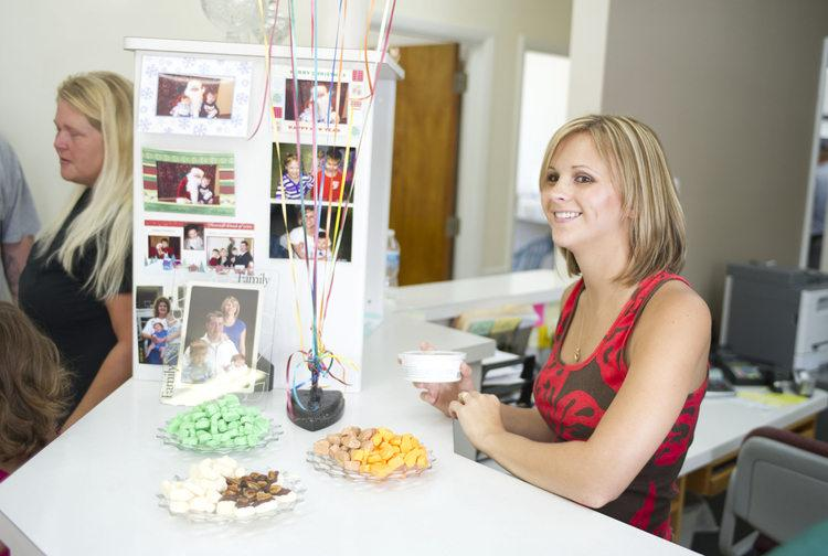 Jennifer Seagraves, owner of Mom Blakeman's, enjoys Friday's 50th anniversary of the Lancaster candy business.