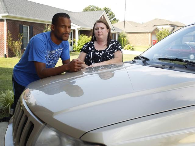 "Damon Dunson and Melanie Stamper of Berea woke last week to find someone had painted racial slurs on their vehicles. ""You just wouldn't imagine the emotions that run through you,"" she said"