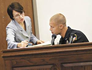 Assistant County Attorney Jill Justice speaks with Bowling Green Police Department Officer Ben Carroll during a pretrial hearing Wednesday for a driving under the influence case at the Warren County Justice Center.