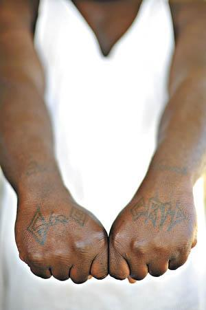 An inmate in the Simpson County Jail displays a Crip tattoo. Jailers pay attention to gang tattoos so they can keep rival gang members away from each other to prevent gang violence in county jails.