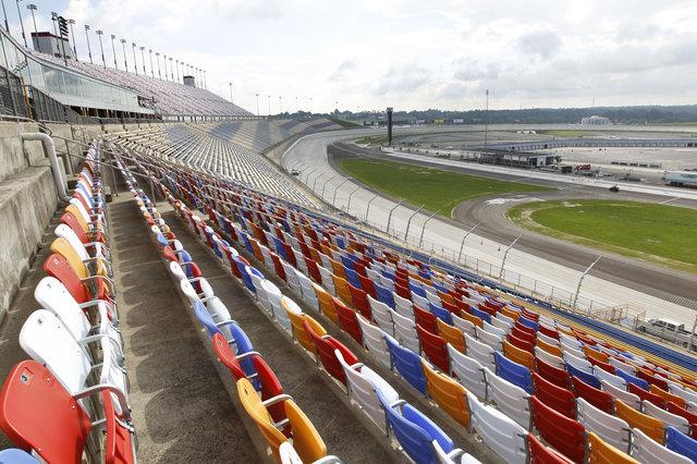 To prepare for its first NASCAR Sprint Cup event Saturday, Kentucky Speedway added two grandstand towers that stand over Turn 4, pictured, and Turn 1. The additions helped push the speedway's seating capacity to 107,000.