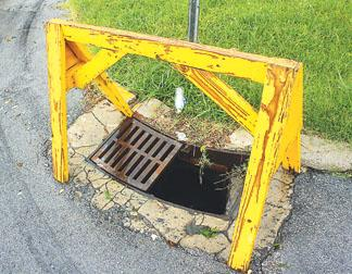 Part of a storm sewer grate along Fourth Street in Corbin has been missing for weeks. Officials say it is one of 16 taken from around the city.