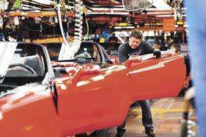 Mike Hathaway installs Corvette windshield seals and tops Tuesday at the Bowling Green Assembly Plant.