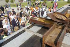 Visitors rotate through Wednesday to touch a remnant of the World Trade Center. The piece will be part of a memorial at Kentucky Veterans Cemetery-Central in Radcliff.