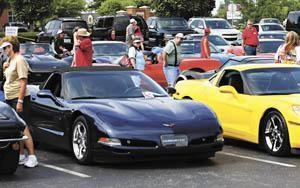 Hundreds of people walk through the parking lot to admire the cars on display Saturday at the National Corvette Homecoming at the Sloan Convention Center.