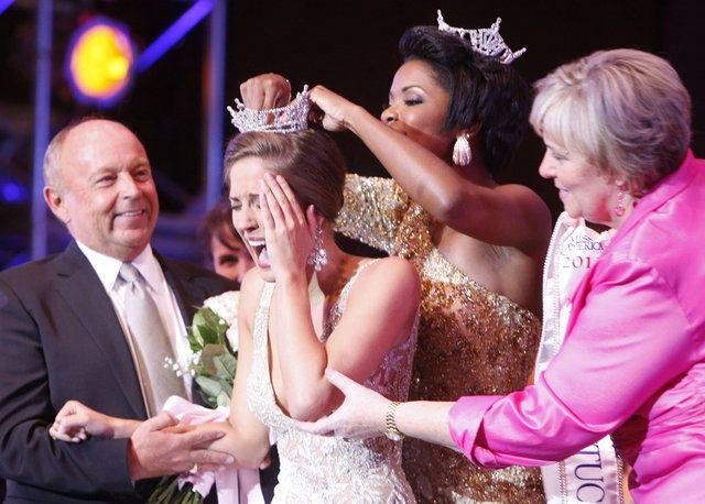 Djuan Trent, Miss Kentucky 2010, put the crown on Miss Bowling Green, Ann-Blair Thornton, after Thornton won the Miss Kentucky Pageant on Saturday at the University of Kentucky Singletary Center for the Arts.