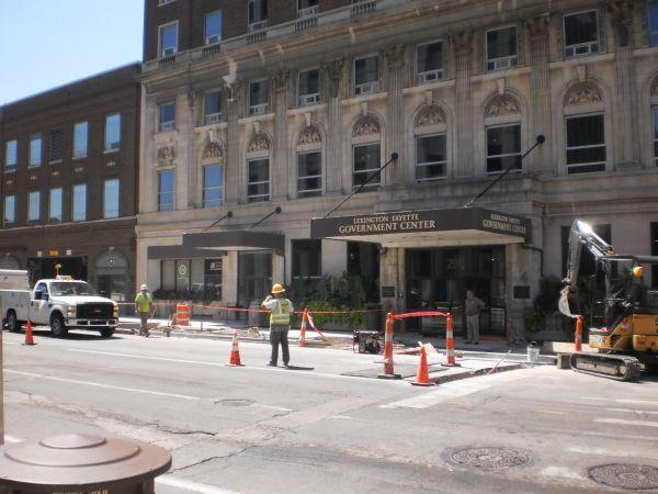 Contractors continue work on the street scape outside city hall in Lexington.