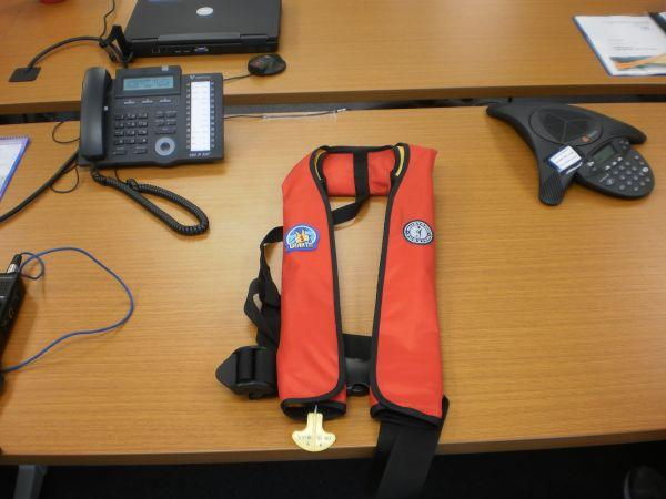 Boat safety officials are always stressing the importance of life jackets on people, not stuck away on the boat.
