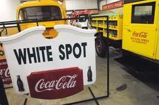 A sign with Coca-Cola advertisment and the White Spot restaurant in downtown Elizabethtown is one of the 750 items being auctioned off in September from the former Schmidt Museum of Coca-Cola Memorabilia.
