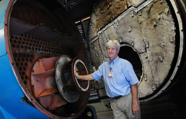 Arnie LeMay, director of engineering at Frankfort Regional Medical Center, stands beside a 16 million BTU boiler.