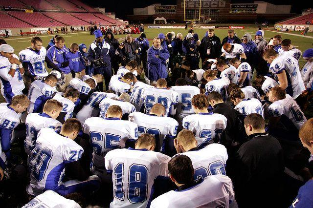 Former Bell County Coach Dudley Hilton led the team in prayer following the Bobcats' Class 4A championship game against Bullitt East in Louisville in December 2008.