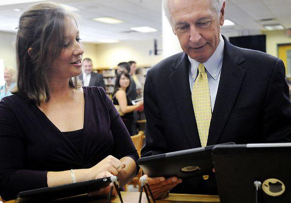 Becky Keith shows Gov. Steve Beshear how she used the iPad in her Spanish class last year during the launch for Kentucky on iTunes U at Woodford County High School Wednesday morning.