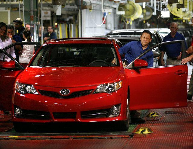 Toyota CEO Akio Toyoda got into the driver's seat Tuesday before the live webcast began introducing the 2012 Camry.