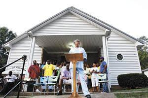 William Elliott of Russellville, a deacon at Mount Zion Baptist Church in Russellville, speaks to the crowd during the opening service of the 25th annual 8th of August Emancipation Celebration.