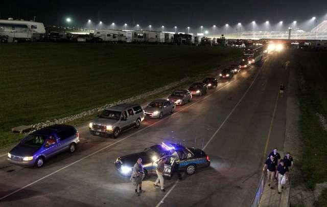 Traffic creeps out of the infield about 1 a.m. 7/10/11 after the inaugural NASCAR Sprint Cup Series Quaker State 400 at Kentucky Speedway, Sparta. The race ended about 11 p.m. All vehicles must exit the infield through a single tunnel.