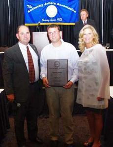 Conrad Lanham, middle, stopped an inmate who threatened a jail nurse. Shelby County Jailer Bobby Waits, left, and Crystal Souders with Southern Health Partners pose with Lanham after he was presented with the Deputy Jailer of the Year award at a conferenc