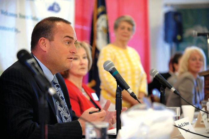 Kentucky state Sen. R. J. Palmer answers one of the questions posed to him and the other state legislatures participating Tuesday in a forum on aging at Rose Mary C. Brooks Place.