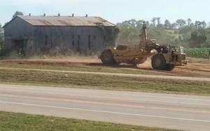 An earth mover work on the new parking lot acquired recently by Kentucky Speedway on Tuesday.