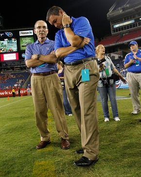 University of Kentucky President Eli Capilouto, left, talked with Athletics Director Mitch Barnhart during UK's game against Western Ketnucky University at LP Field in Nashville.