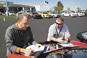 Joseph Taverna (left) of Quebec, Canada, and Tim Flanary of Mount Airy, Md., plan their route Thursday from the National Corvette Museum to Clarksville, Tenn., during the Chevrolet Fireball Run.