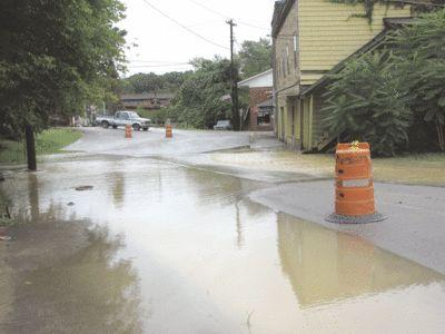 Cumberland Avenue in downtown Cumberland was blocked off to traffic on Tuesday when drains overflowed covering the roadway.