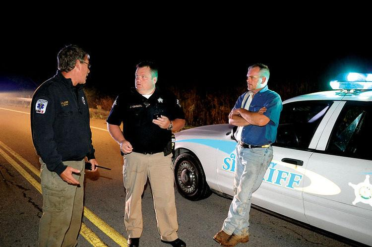 Winchester Fire Department Major Greg Beam, left, talks with Clark County Deputy Sheriff Johnny Graves and Allen Taylor, right, at a road block on Irvine Road a few miles from a natural gas pipeline rupture. Beam, who lives in Camargo, said the windows in