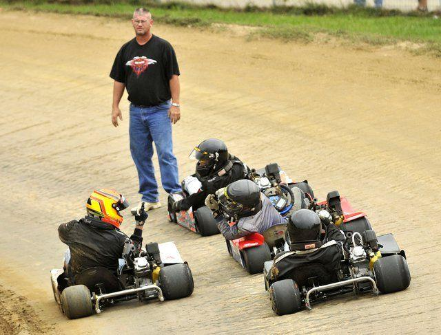 Tempers flared on the track Sunday during the qualifying stages of a $50,000 go-kart race at Clay City Kart Speedway. The championship race was run at night.