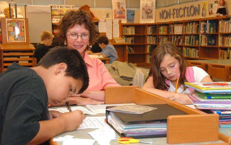Trailblazer volunteer Dianna Reed helps Colyn Young, left, and Grace Powe with their homework during the Hannah McClure Homework Club. The club meets every Wednesday afternoon after school