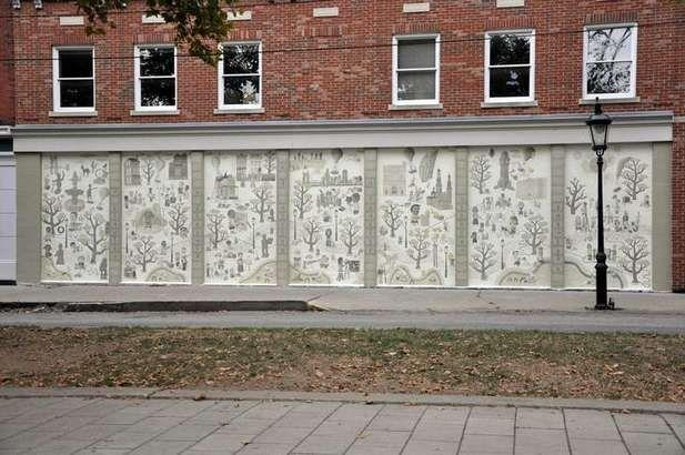 "This mural, titled ""An Epic of Time and Town,"" is on the front of the John R. Green building in Covington, 411 W. 6th St."