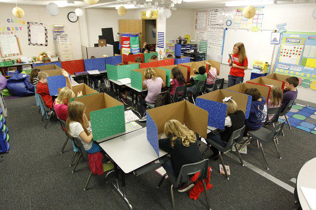 Third-grade teacher Kelly Morris gave her class a morning work test in her portable classroom at Liberty Elementary last week. The rapid growth in Fayette schools, has forced many schools, to add portable classrooms.