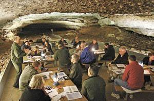Bruce Powell (left) of Bowling Green, deputy superintendent at Mammoth Cave National Park, speaks Wednesday during a Biosphere Reserve Council meeting in the Snowball Dining Room at Mammoth Cave.