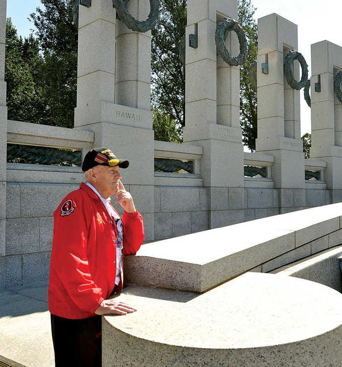 Ernest Snowden surveyed the scene at the World War II Memorial Thursday. Snowden fought in the South Pacific and was wounded twice.