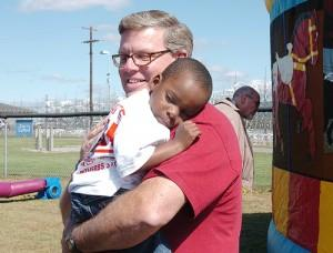 A tender moment is shared by David Scott, minister of music at Southside Baptist Church, and a son of one of the inmates at Western Kentucky Correctional Complex.