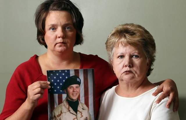 "Jennifer Allen (left) and her mother, Patricia Allen, with a photo of Jennifer's son, Chris Allen, 19, who is in a mental hospital. They blame his mental health problems on his use of a product sold under names such as ""Dead Man Walking,"" which he smoked."