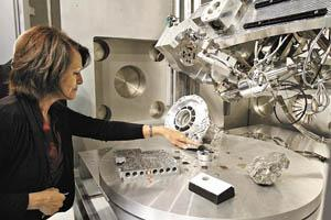 Denise Mitchell of Bowling Green leans in Tuesday for a closer look at the Large Chamber Scanning Electron Microscope at Western Kentucky University�s NOVA Center.
