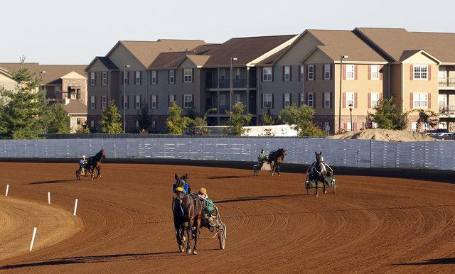 Drivers at The Red Mile worked their horses on the backstretch, where an apartment complex already exists. The Red Mile plans to sell 10 acres including its Tattersalls sales pavilion to create more housing aimed toward university students.
